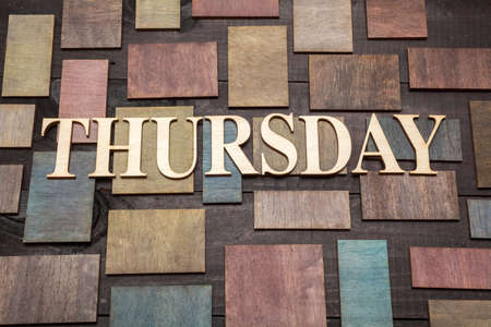 thursday: Wooden letters forming word THURSDAY written on wooden background