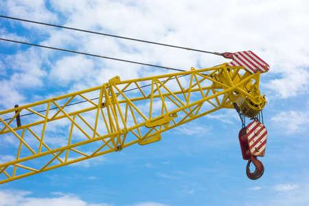 jib: A Crane boom with main block and jib against a clear blue sky