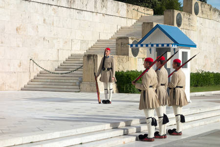 tsolias: ATHENS, GREECE - MAY 15: Evzones changing the guard at the Tomb of the Unknown Soldier in front of the Greek Parliament Building at Syntagma Square on May 15, 2014 in Athens,Greece.