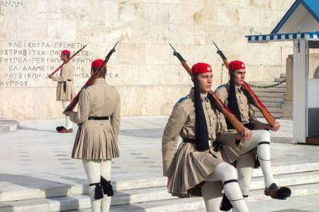 ATHENS, GREECE - MAY 15: Evzones changing the guard at the Tomb of the Unknown Soldier in front of the Greek Parliament Building at Syntagma Square on May 15, 2014 in Athens,Greece.