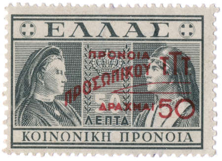 overprint: GREECE - CIRCA 1939: Postage stamps printed in Greece, shows Queen Olga and Queen consort of the Hellenes (overprint Social Care, 1946), circa 1939   Stock Photo