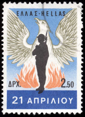 GREECE - CIRCA 1967: A stamp printed in Greece , from the 21st April 1967 issue shows a renascent phoenix and a soldier which was the emblem of the military junta, circa 1967.   photo