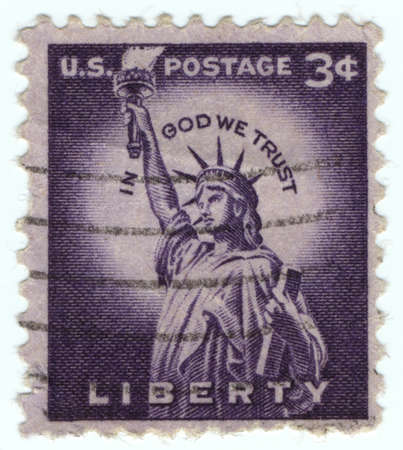 enlightening: UNITED STATES - CIRCA 1954: stamp printed in United states, shows Statue of Liberty, with the inscription in God We Trust, from the series Liberty Issue circa 1954