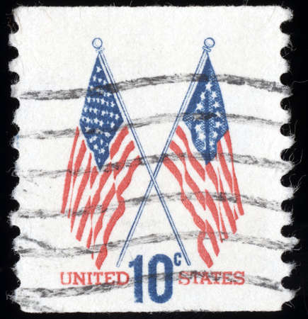 usps: UNITED STATES OF AMERICA - CIRCA 1973: A stamp printed in the United States shows two US flags, circa 1973 Editorial