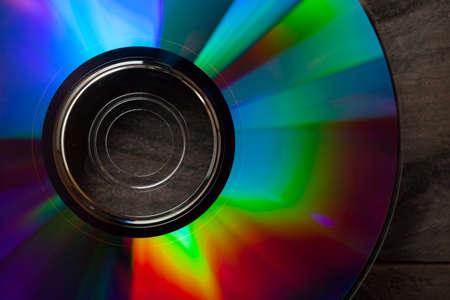 Dvd on dark wooden table. Stock Photo