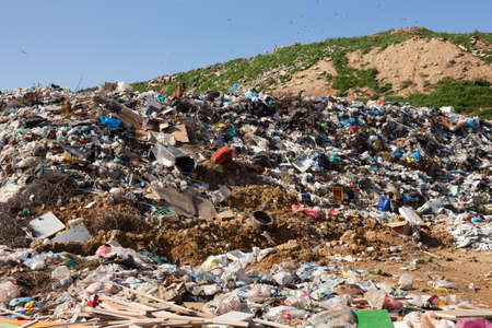 exists: ALEXANDROUPOLIS, GREECE - MARCH 30: A section of a landfill located on March 30, 2014 in Alexandroupolis, Greece. Though forbidden this way for the municipality garbage, still exists.   Editorial