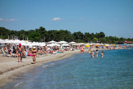 makri: ALEXANDROUPOLIS, GREECE - JULY 03: People sunbathing on the beach on July 03, 2014 in Agia Paraskevi, Makri, Greece. Tourist destination with clear sea
