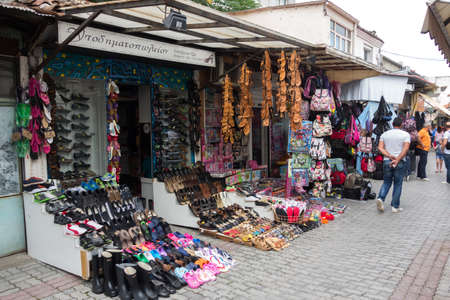 coexist: KOMOTINI, GREECE - JULY 2, 2014: View of the old city and stores with tools. Orthodox Christians and Muslims coexist harmoniously in the Thracian valley for many years