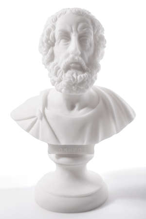 poems: Homer (800–701 B.C.E.) is the author of the Iliad and the Odyssey, and is revered as the greatest of Greek epic poets. Sculpture isolated on white background Stock Photo