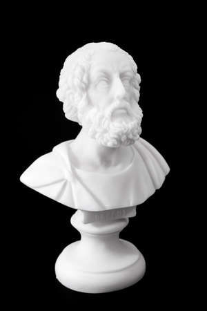 homer: Homer (800–701 B.C.E.) is the author of the Iliad and the Odyssey, and is revered as the greatest of Greek epic poets. Sculpture isolated on black background