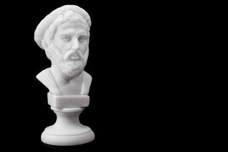 Pythagoras of Samos (570–490 B.C.E.) was an important Greek philosopher, mathematician, geometer and music theorist. Sculpture isolated on black background
