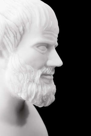 classical greece: Greek philosopher Aristotle (384–322 B.C.E.) sculpture isolated on black background  Stock Photo