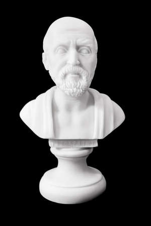 hippocratic: Hippocrates (460–380 B.C.E.) Ancient Greek physician, traditionally regarded as the father of medicine. Sculpture isolated on black background