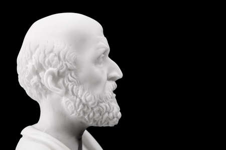 hippocrates: Hippocrates (460–380 B.C.E.) Ancient Greek physician, traditionally regarded as the father of medicine. Sculpture isolated on black background