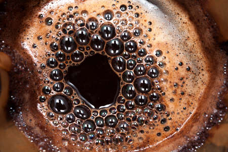 percolate: Jug of dripping fresh hot coffee, blended coffee on paper filter