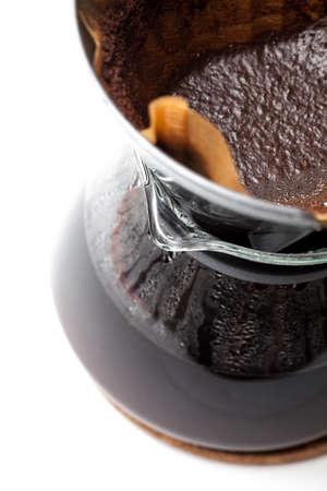percolate: Filter coffee into a glass jug