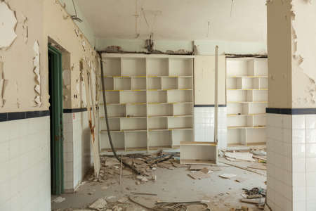 degradation: Interior of an abandoned building with rubble and debris. Deserted old hospital