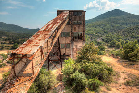Old abandoned mine in the mountainous regions of Greece photo