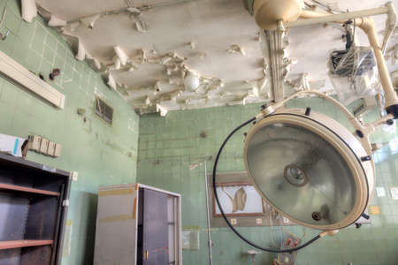 Interior of an abandoned building with rubble and debris. Deserted old hospital
