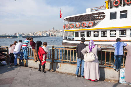ISTANBUL - OCTOBER 7: People get on board the ship at Eminonu on October 7, 2014 in Istanbul. Nearly 150,000 passengers use ferries daily in Istanbul, due to easy access to two different continents.