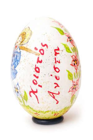 Handmade painted Easter egg on white from Greece