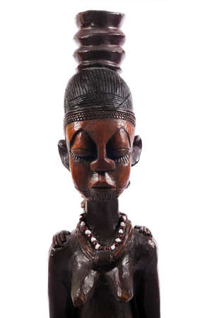 artifact: African wooden figure against white background Editorial