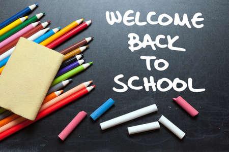 welcome desk: Welcome back to school. School tools around. Blackboard background.