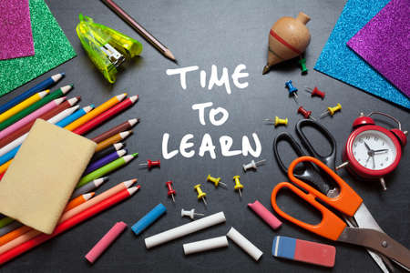 Time for learn. School tools around. Blackboard background. photo