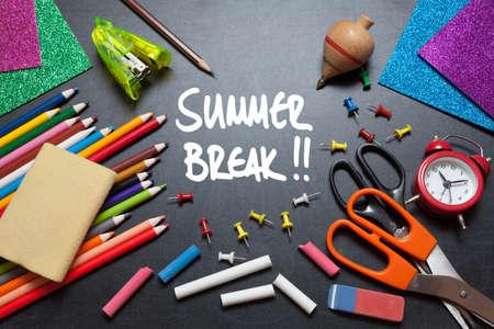 Summer break. School tools around. Blackboard background. Reklamní fotografie