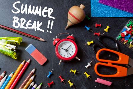 Summer break. School tools around. Blackboard background. Stock Photo
