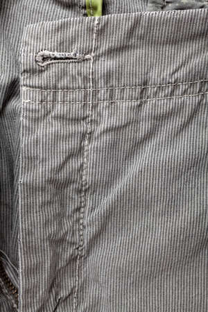 Detail of gray casual cotton mens trousers photo