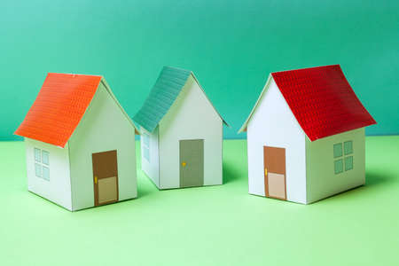 dwelling: Papercraft House. Small houses from paper. Quality of life concept.