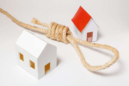 Small house with hangmans noose on white background