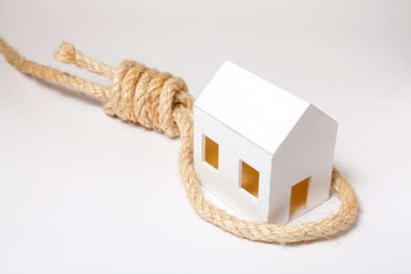 slipknot: Small house with hangmans noose on white background