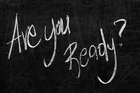 Geschreven ben je klaar? op het bord met wit krijt Stockfoto