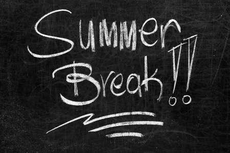 summer break: Written summer break!! on the blackboard with white chalk