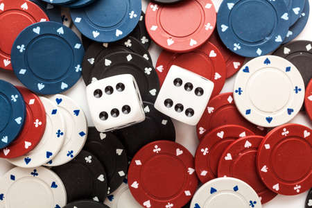Chips for poker and dice on white background photo
