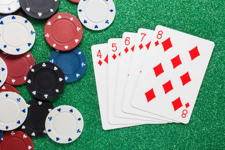 straight flush: Straight Flush. Playing cards isolated on a green with poker chips scattered Stock Photo