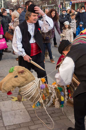 cultural and ethnic clothing: ALEXANDROUPOLIS, GREECE - DEC 31, 2015: Revival of the custom of camel by the Cultural Educational Association of Eastern Rumelia Ebrou around the Town Hall in the city center Editorial