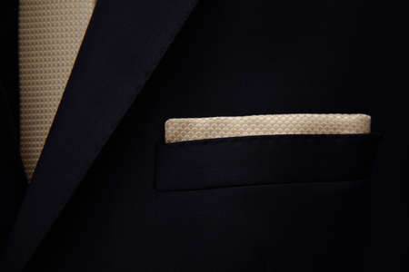 lapel: Groom suit with scarf on his lapel