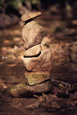 Beautiful stacked brown stone stones tower cairn Stock Photo