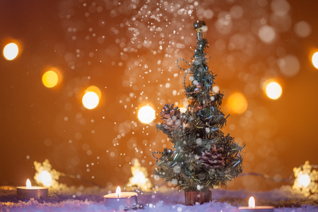 chirstmas background with christmas tree snow candles lights bokeh lights snowing