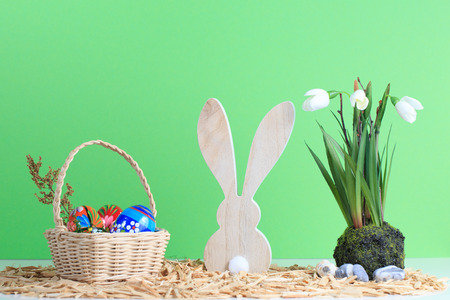 Easter arrangement with easter basket, bunny and snowdrop flower Stock Photo