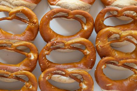 Fresh tasty Bavarian pretzels on white table 스톡 콘텐츠