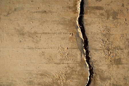 cracked cement: Crack in concrete wall creating a grunge texture