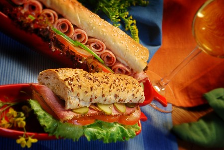 Two large ham subs on a colourful background Stock Photo - 7816135