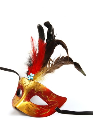 A feathered mask isolated on a white background