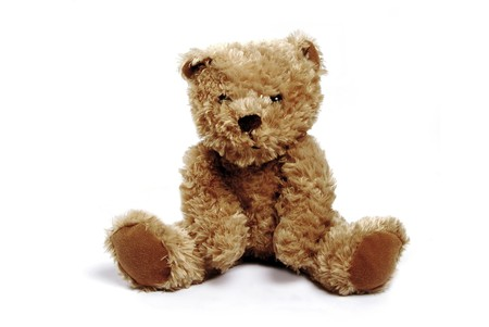 Single brown teddy bear isolated on a white background photo