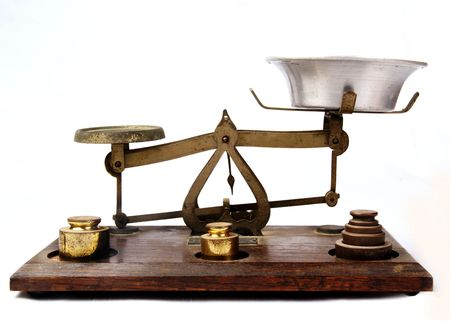 antique weight scale: Antique bronze scale on a wooden base isolated on a white background