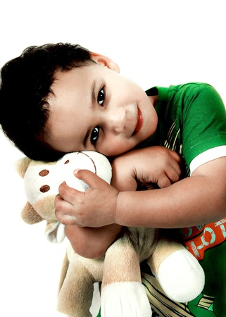 white bear: A small child cuddling a fluffy toy isolated on a white background